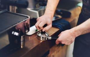 barista making espresso