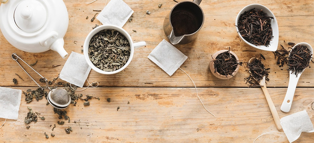 dry tea leaves tea bags and teapot